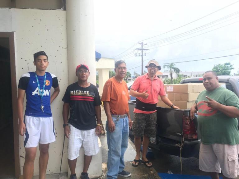 Pastor Lito and Pastor Eric with their outreach team